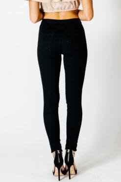 Ψηλόμεσο skinny τζιν με σκίσιμο στο γόνατο